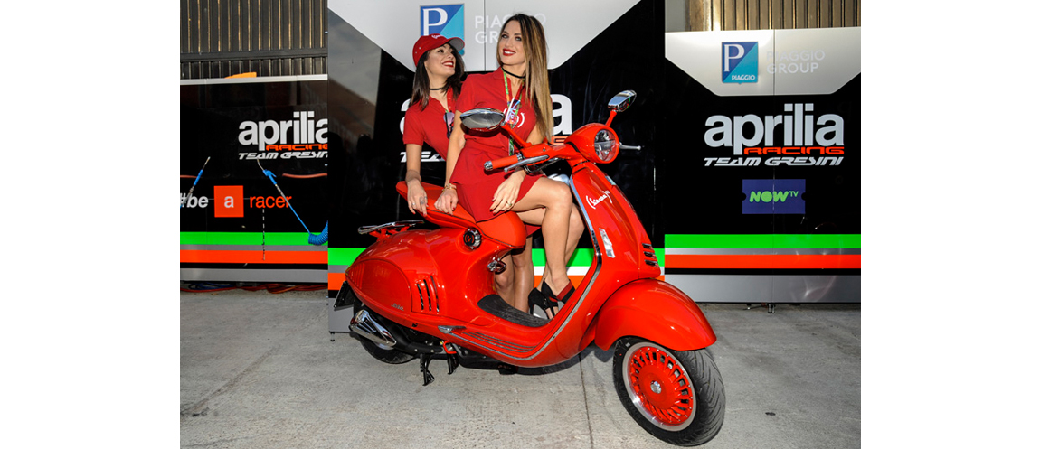 """On the occasion of the last MotoGP in Valencia the whole Aprilia Racing team and the RS-GP bikes, they """"dressed"""" in (RED)."""
