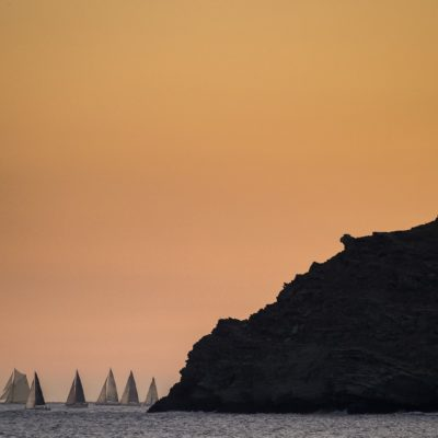 THE ROLEX GIRAGLIA FLEET APPROACHING THE GIRAGLIA ROCK AT SUNRISE ON THE SECOND DAY OF THE OFFSHORE RACE