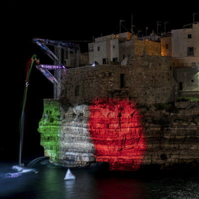 Alessandro De Rose of Italy dives from the 21 metre platform prior to the third stop of the Red Bull Cliff Diving World Series in Polignano a Mare, Italy on May 30, 2019. // Dean Treml/Red Bull Content Pool // AP-1ZGJXBBU52111 // Usage for editorial use only // Please go to www.redbullcontentpool.com for further information. //
