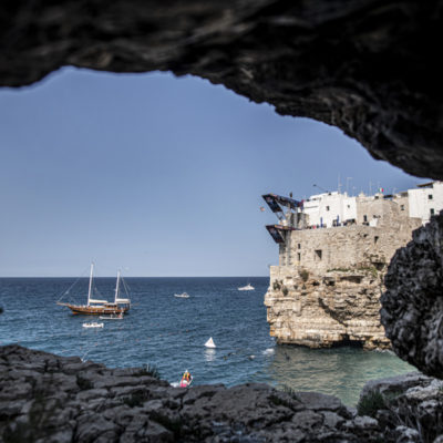 Gary Hunt of the UK dives from the 27 metre platform during the first competition day of the third stop of the Red Bull Cliff Diving World Series in Polignano a Mare, Italy on June 1, 2019. // Dean Treml/Red Bull Content Pool // AP-1ZGZHFHPH2111 // Usage for editorial use only // Please go to www.redbullcontentpool.com for further information. //
