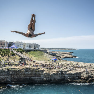 Alessandro De Rose of Italy dives from the 27 metre platform during the first competition day of the third stop of the Red Bull Cliff Diving World Series in Polignano a Mare, Italy on June 1, 2019. // Romina Amato/Red Bull Content Pool // AP-1ZGZRW8RN2111 // Usage for editorial use only // Please go to www.redbullcontentpool.com for further information. //