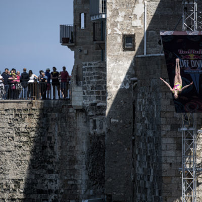 Yana Nestsiarava of Belarus dives from the 21 metre platform during the first competition day of the third stop of the Red Bull Cliff Diving World Series in Polignano a Mare, Italy on June 1, 2019. // Dean Treml/Red Bull Content Pool // AP-1ZGZVPSE92111 // Usage for editorial use only // Please go to www.redbullcontentpool.com for further information. //