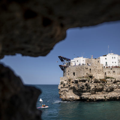 Jonathan Paredes of Mexico dives from the 27 metre platform during the first competition day of the third stop of the Red Bull Cliff Diving World Series in Polignano a Mare, Italy on June 1, 2019. // Dean Treml/Red Bull Content Pool // AP-1ZGZVS2912111 // Usage for editorial use only // Please go to www.redbullcontentpool.com for further information. //