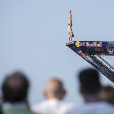 Michal Navratil of the Czech Republic dives from the 27 metre platform during the first competition day of Red Bull Cliff Diving World Series 2019 Stop 3, Polignano a Mare, Italy on June 1, 2019 // Elena Mancini / Red Bull Content Pool // AP-1ZH13649H2111 // Usage for editorial use only // Please go to www.redbullcontentpool.com for further information. //