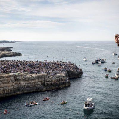 Gary Hunt of the UK dives from the 27 metre platform during the final competition day of the third stop of the Red Bull Cliff Diving World Series in Polignano a Mare, Italy on June 2, 2019. // Dean Treml/Red Bull Content Pool // AP-1ZHA38CWH2111 // Usage for editorial use only // Please go to www.redbullcontentpool.com for further information. //
