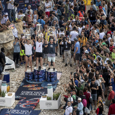 (L-R) Michal Navratil of the Czech Republic, Gary Hunt of the UK and Andy Jones of the USA celebrate on the podium during the final competition day of the third stop of the Red Bull Cliff Diving World Series in Polignano a Mare, Italy on June 2, 2019. // Dean Treml/Red Bull Content Pool // AP-1ZHA3EMGW2111 // Usage for editorial use only // Please go to www.redbullcontentpool.com for further information. //