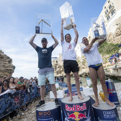 Andy Jones of the USA, Gary Hunt of the UK and Michal Navratil of the Czech Republic celebrate on the podium after the third stop of the Red Bull Cliff Diving World Series in Polignano a Mare, Italy on June 2, 2019. // Romina Amato/Red Bull Content Pool // AP-1ZHABDQPD2111 // Usage for editorial use only // Please go to www.redbullcontentpool.com for further information. //