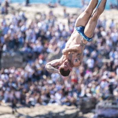 Alessandro De Rose of Italy dives from the 27 metre platform during the final competition day of Red Bull Cliff Diving World Series 2019 Stop 3, Polignano a Mare, Italy, on June 2, 2019 // Elena Mancini / Red Bull Content Pool // AP-1ZHAZYHYH2111 // Usage for editorial use only // Please go to www.redbullcontentpool.com for further information. //