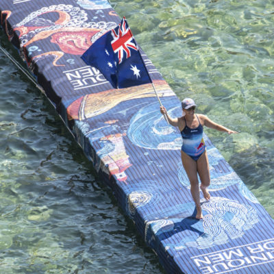 Rhiannan Iffland of the Australia carrying her flag during the final competition day of Red Bull Cliff Diving World Series 2019 Stop 3, Polignano a Mare, Italy, on June 2, 2019 // Elena Mancini / Red Bull Content Pool // AP-1ZHB4G3692111 // Usage for editorial use only // Please go to www.redbullcontentpool.com for further information. //