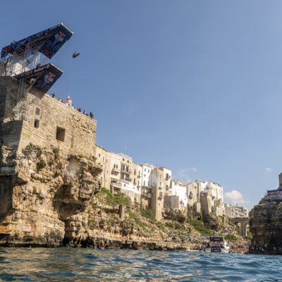 Catalin Preda of Romania dives from the 27 metre platform during the final competition day of the third stop of the Red Bull Cliff Diving World Series in Polignano a Mare, Italy on June 2, 2019. // Olaf Pignataro/Red Bull Content Pool // AP-1ZHJTYM3H1W11 // Usage for editorial use only // Please go to www.redbullcontentpool.com for further information. //