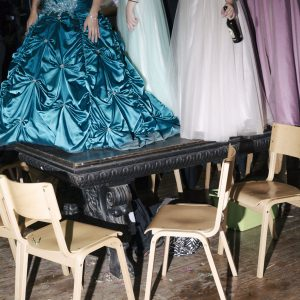 Ladies of the royal household are standing on the royal table in Brunskappel. The royal household is chosen by the King and the Queen and has to dress up for the ball and the marches through the village. It is common practice that late at night the marching band plays directly at the king table and the people stand on the table and chairs.